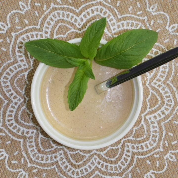 overhead photo ot a bowl full of garlic tahini sauce