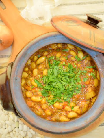 overhead view of baked beans in clay pot