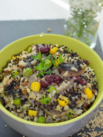 ¾ view of a bowl full of brown rice rissotto