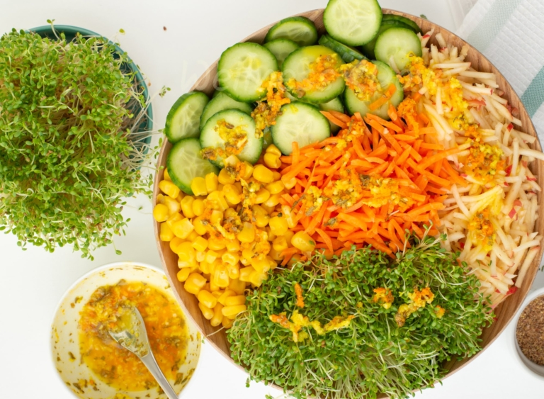 Sprout salad, dressing and sprouts, overhead