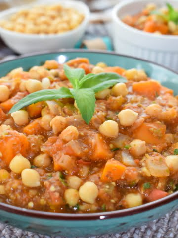 A plate full of vegan chickpea stew with eggplant and sweet potato ¾ shot
