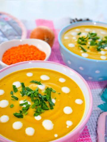 a bowl full of vegan red lentils cream soup ¾ shot