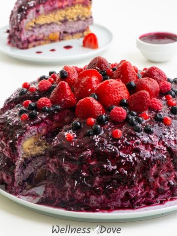 Super juicy and fresh whole plant foods cake. No sugar and no oil! It is filled with fresh fruits and layered with this fantastic, creamy blueberry frosting! All this covered with the tastiest blueberry topping ever! This cake is a perfect dessert for any occasion or whenever you need something sweet and healthy!