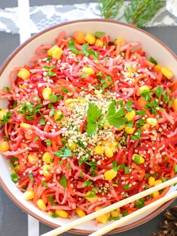 A bowl of shredded vegan salad overhead view
