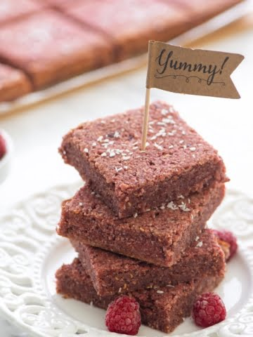 An easy and quick plant-based recipe that is 100% vegan and oil-free! Only whole food ingredients are used! These almond raspberry snack bars are super healthy and chewy. Raw almonds are combined with fresh raspberries and coconut flour, sweetened with dates for a complete taste sensation!