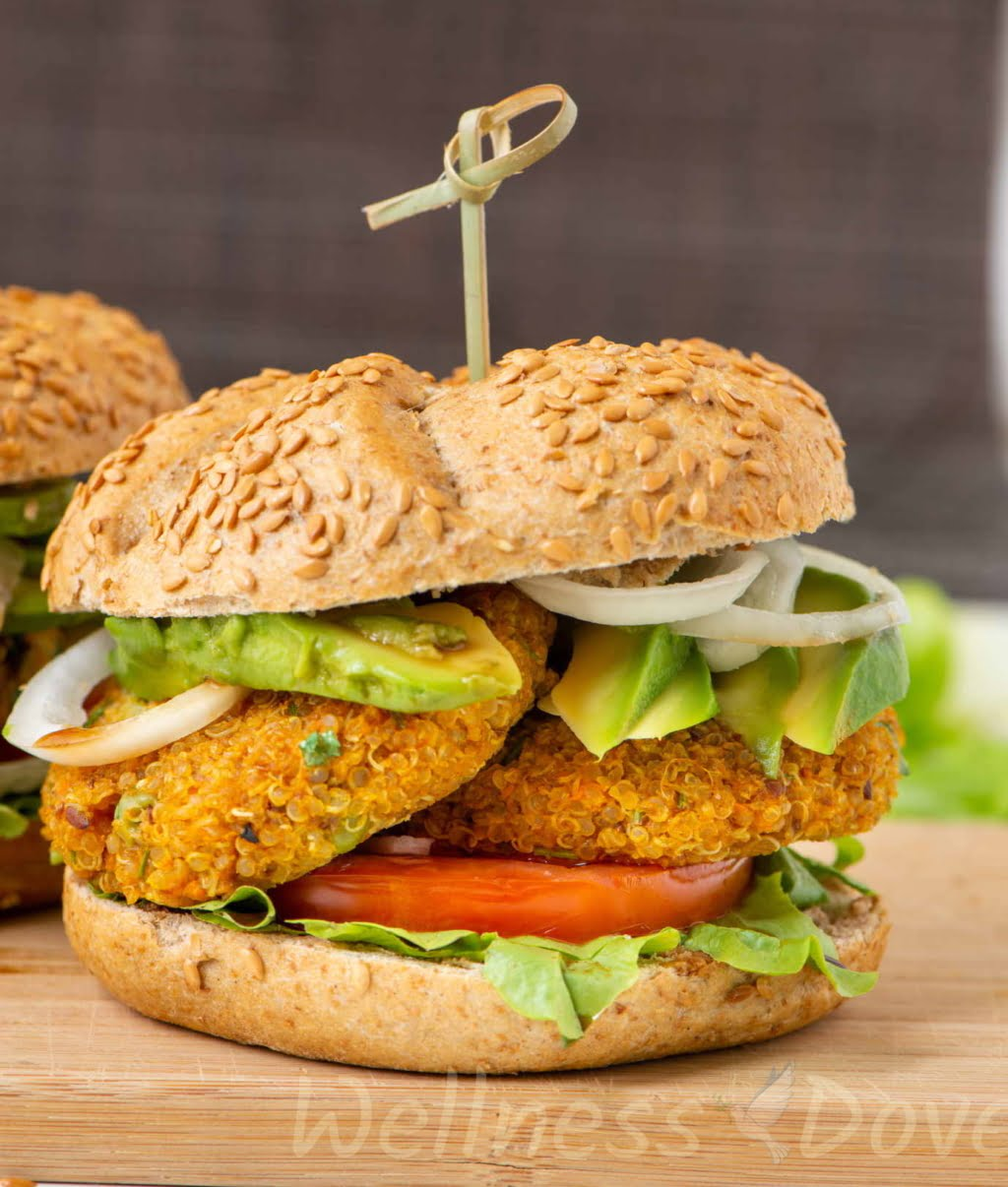 a vegan quinoa burger on a wooden chopping board