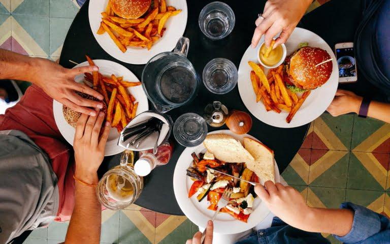 overhead photo of people eating burgers