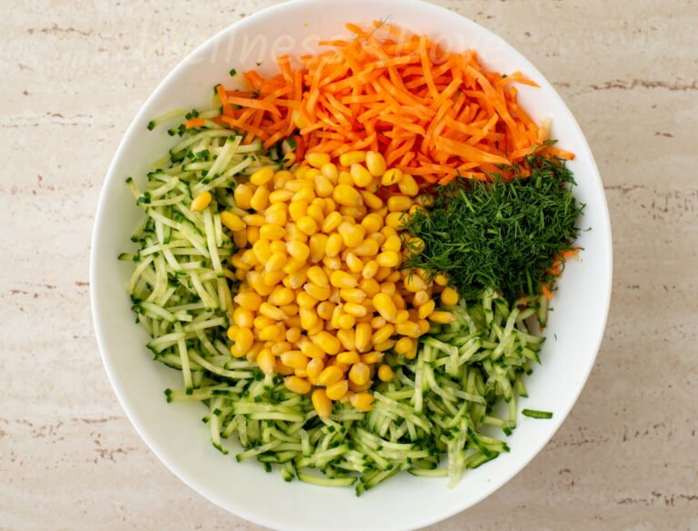a large bowl with the ingredients of the vegan salad, unmixed