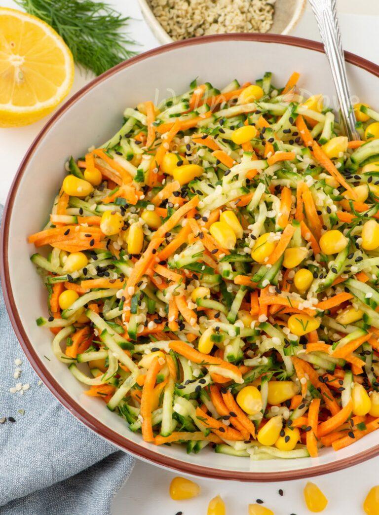 a bowl of fresh cucumber carrot salad