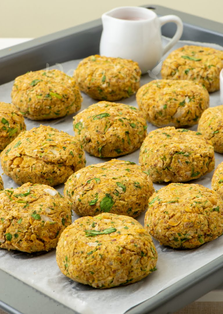 a baking tray with homemade falafels
