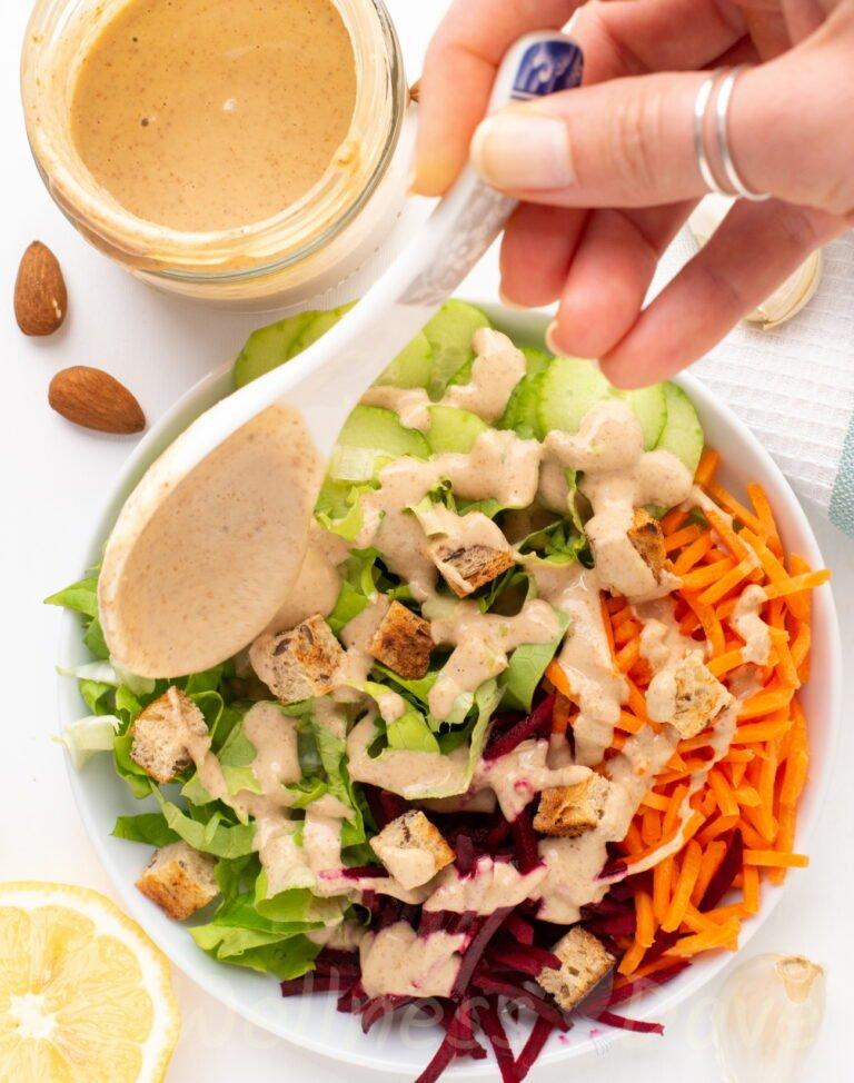 Salad seasoned with vegan no oil salad dressing overhead photo