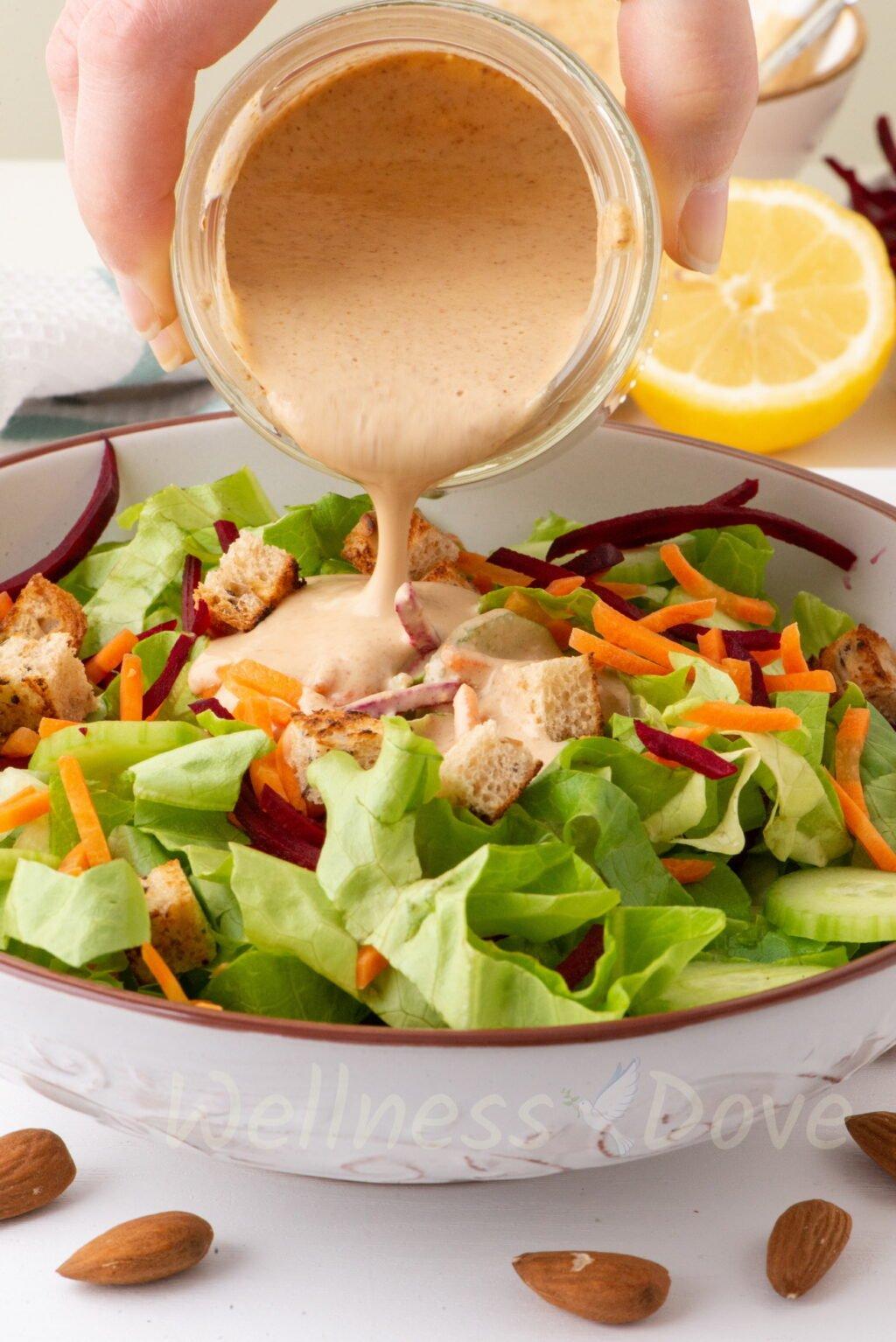 seasoning a salad with vegan dressing