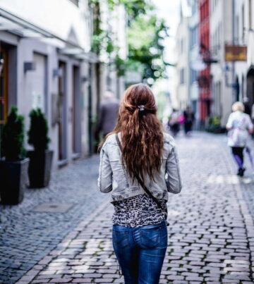 Woman walking down a small town street