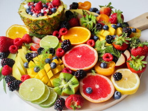 a board full of different chopped fruits