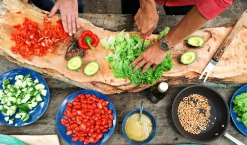 people chopping salad