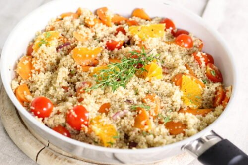 cooked quinoa with veggies in a pan